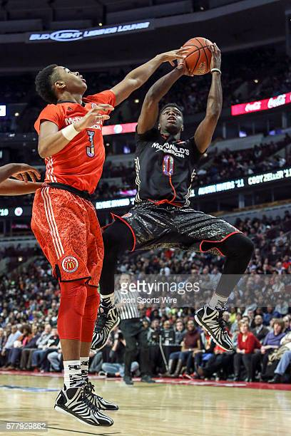 McDonald's All American East Boys Team D'angelo Russell battles with McDonald's All American West Boys Team Emanuel Mudiay in action during the 2014...