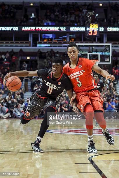 McDonald's All American West Boys Team Emanuel Mudiay battles with McDonald's All American East Boys Team D'angelo Russell in action during the 2014...