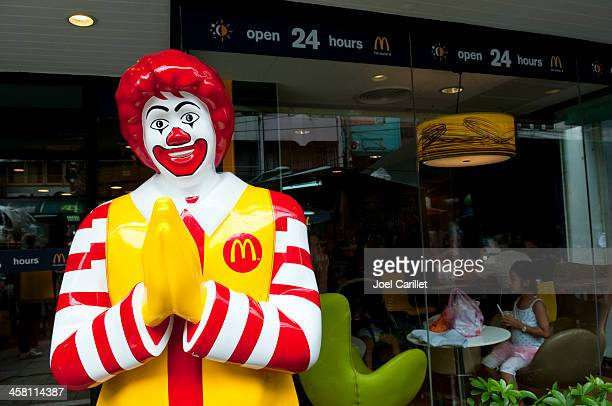 mcdonald's and culture in thailand - ronald mcdonald stock photos and pictures