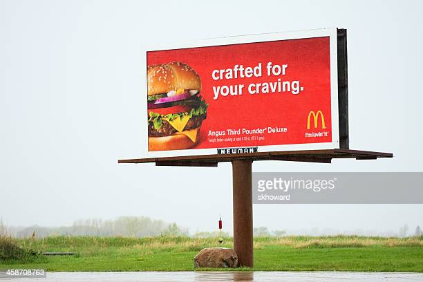 mcdonalds billboard advertising - unhealthy eating stock pictures, royalty-free photos & images