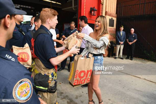 McDonald's CEO Steve Easterbrook and Chrissy Teigen share McDelivery with the Hoboken Fire Department on July 25 2017 in Hoboken City