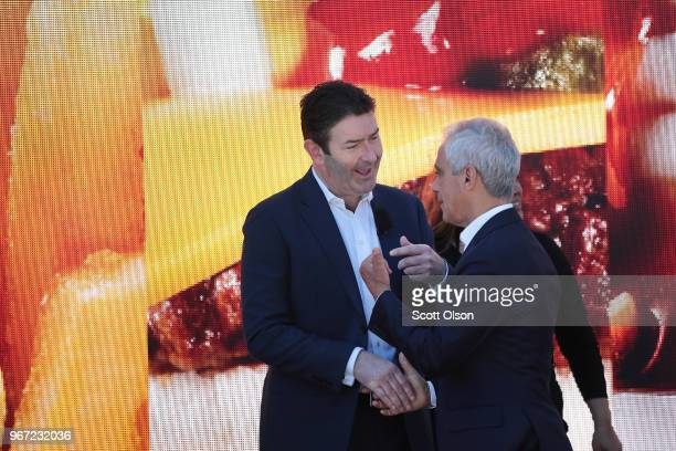 McDonald's CEO Steve Easterbrook chats with Chicago Mayor Rahm Emanuel at the unveiling of the company's new corporate headquarters on June 4 2018 in...