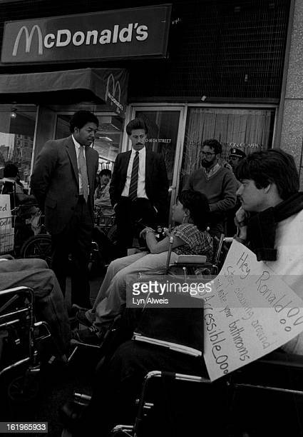 MAY 8 1984 MAY 9 1984 McDonald's Corp burger chain will try to accommodate wheelchair customers Pixprotest McDonald's Protest Standing representing...