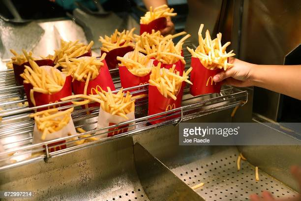 McDonald's crew member Samantha Medina prepares french fries as the McDonald's restaurant stock price reached record territory on April 25 2017 in...