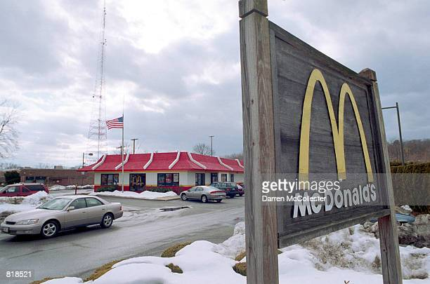McDonald's customer drives away March 24 2001 from one of it's chain restaurants in Needham MA Hamburger giant McDonald's Corp warned Wednesday that...