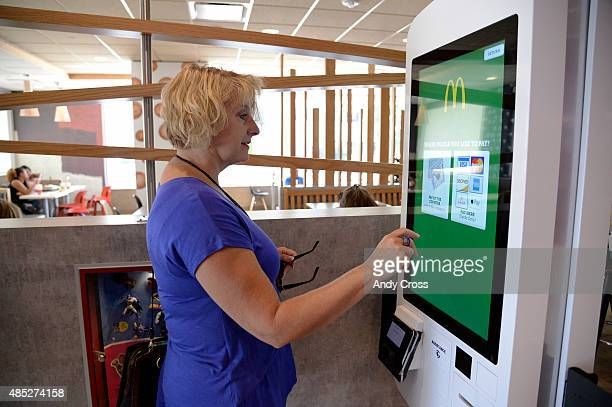 McDonalds customer Jan Ferrell orders a custom meal from the Create Your Taste kiosk at 4000 S Parker Rd August 26 2015 This McDonalds is testing a...