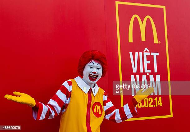A McDonald's doorman gestures during the opening ceremony of the country's first McDonald's restaurant in Ho Chi Minh city on February 8 2014 Four...