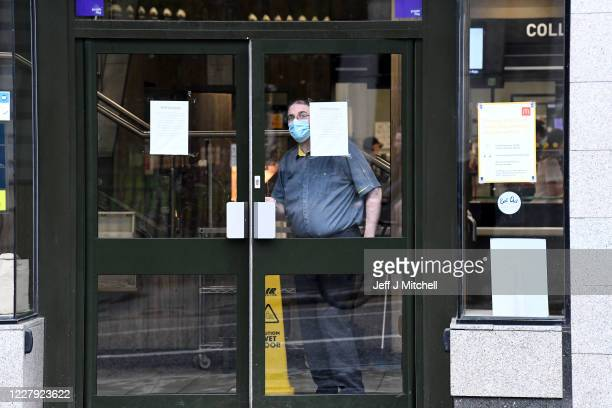 McDonalds employee is seen as the restaurant is only open for take away on August 5, 2020 in Aberdeen, Scotland. Scotland's First Minister Nicola...