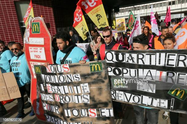 McDonald's employees and union members hold placards reading « We want equal rights for all » and « popular districts in revoltquot as they protest...