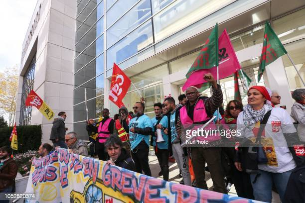 McDonald's employees and union members hold placards signs and union flags as they protest against the tax evasion and the low salary outside the...