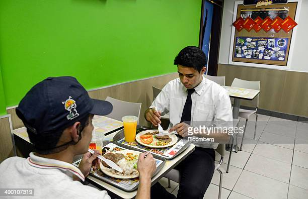 McDonald's employees eat a meal served with rice and beans inside a McDonald's Corp restaurant in Barueri Brazil on Tuesday April 29 2014 After being...