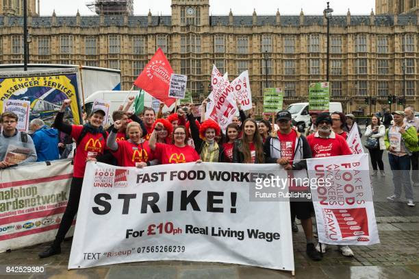 McDonald's employees trade unionists and campaigners for fast food workers' rights gather in Old Palace Yard outside parliament for a rally on the...