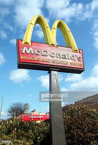 McDonald's famous golden arches catches sunlight March 14 2001 at one of it's chain restaurants in Boston MA Hamburger giant McDonald's Corp warned...