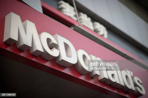 A McDonald's fast food restaurant sign is seen in Beijing on January 9 2017 US fastfood giant McDonalds will sell a controlling stake in its China...
