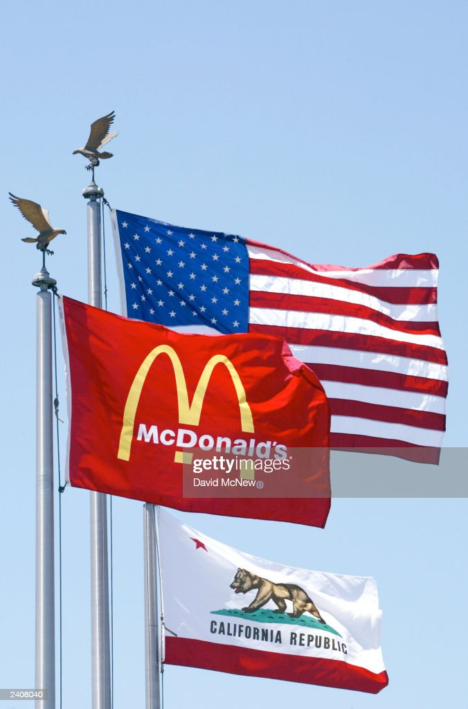 A McDonald's flag flies with the American and California flags at the world's oldest-operating McDonald's fast food restaurant on its 50-year anniversary on August 18, 2003 in Downey, California. This 'Speedee' McDonald's, so named for the original chef logo, was the third restaurant built by the McDonald brothers Dick and Maurice and is a national landmark.