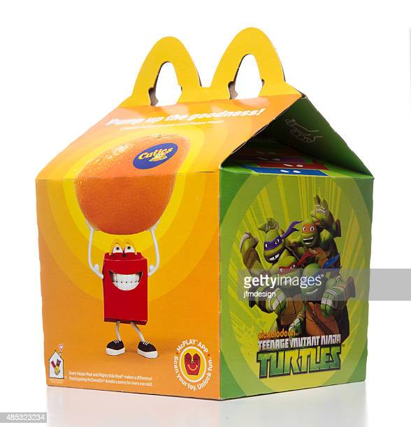 mcdonalds happy meal box with ninja turtles promo - happy meal stock photos and pictures