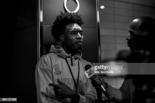 McDonald's High School AllAmerican guard Collin Sexton gives interviews to the media during the McDonald's AllAmerican Games Media Day on March 28 at...