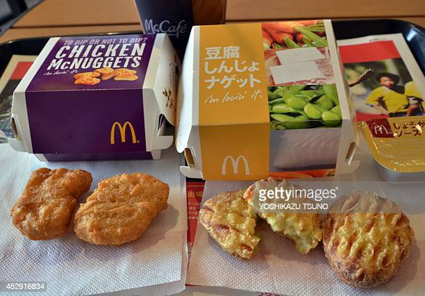 McDonald's Japan's new tofu products 'Tofu Shinjo Nuggets' and Chicken McNuggets are displayed at a McDonald's restaurant in Tokyo on July 30 2014...