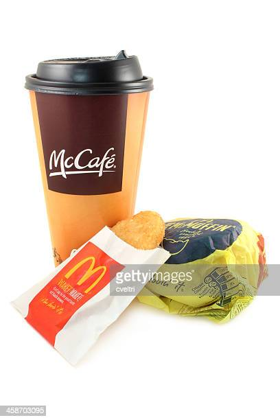mcdonald's | mccafe coffee, hash brown and an egg mcmuffin - mcdonald's stock pictures, royalty-free photos & images