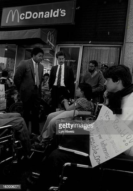 MAY 8 1984 MAY 9 1984 McDonalds protest standing representing the store on left Dennis Morris on right Bob Wilner woman that they are speaking to...