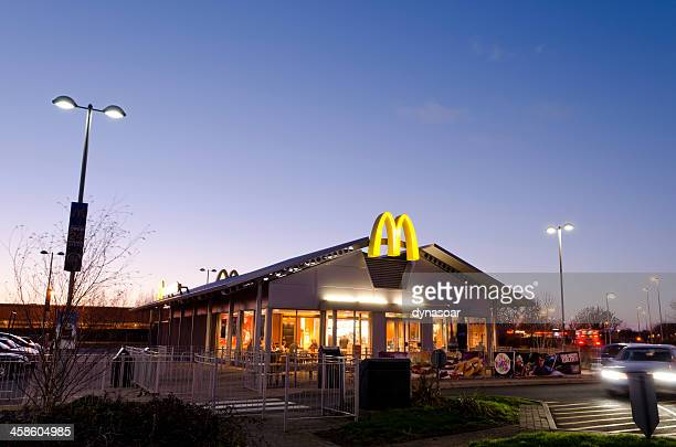 mcdonald's restaurant at dusk, united kingdom - weston super mare stock pictures, royalty-free photos & images