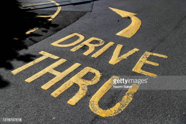 McDonalds' restaurant drive thru road signage is seen as the store is closed due to the current coronavirus pandemic on April 19, 2020 in...