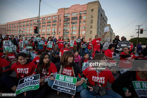 McDonald's restaurant employees rally near the American Apparel factory after walking off the job to demand a $15 per hour wage and union rights...