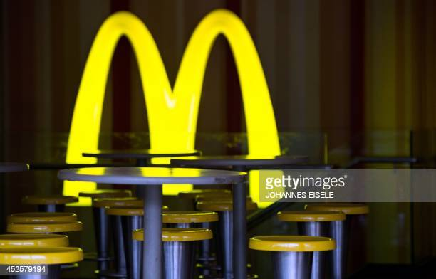 A McDonald's restaurant opens its doors early on July 24 2014 in Shanghai Chinese police on July 23 detained five people from a unit of US food...