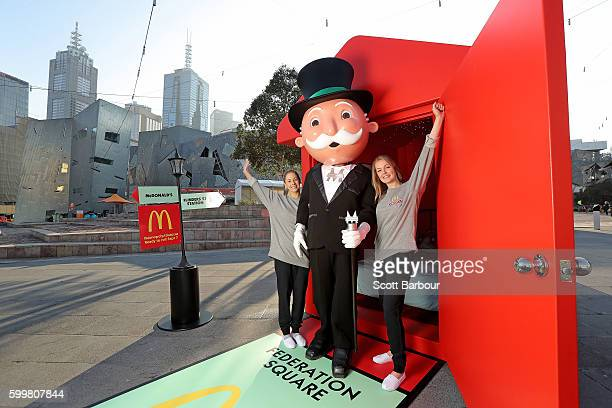 McDonalds superfans Laura Paton and Emma Kendrick pose with Mr Monopoly as they relax in McDonalds Monopoly Hotel at Federation Square on September 7...