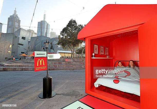 McDonalds superfans Laura Paton and Emma Kendrick relax in bed at McDonalds Monopoly Hotel at Federation Square on September 7 2016 in Melbourne...