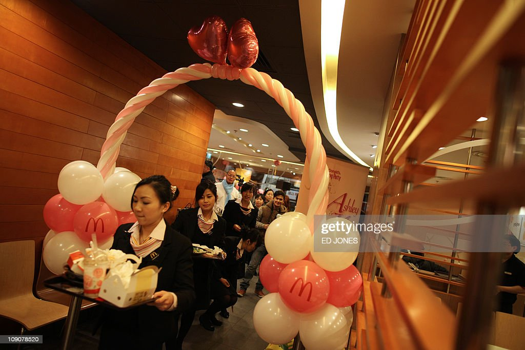 mcdonalds-waitresses-walk-through-a-wedding-themed-decoration-during-picture-id109078520