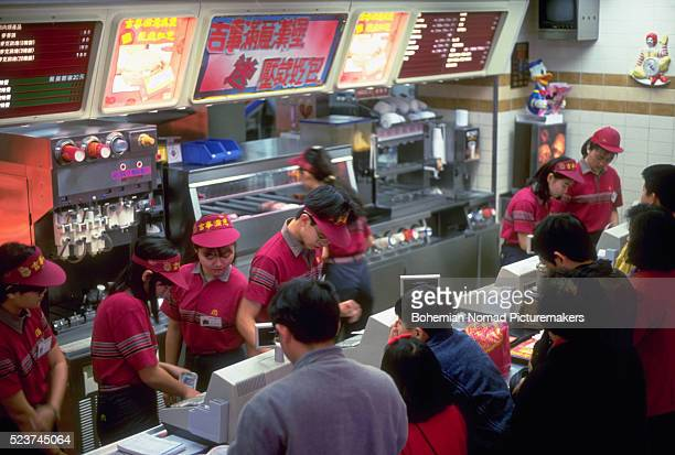 mcdonald's workers in taipei - mcdonald's stock pictures, royalty-free photos & images