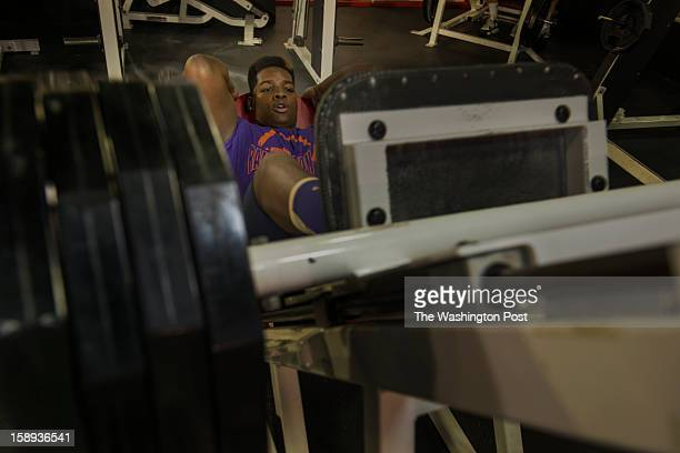 McDonough High School football player Na'Ty Rodgers working out his quadriceps on the leg press machine at the Sport & Health Club in Waldorf,...