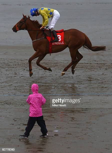 McEnery on Option Be make their way to the star tof thr fifth race the O'Neills Sports Handicapat the Laytown beach racetrack on September 11 2008 in...