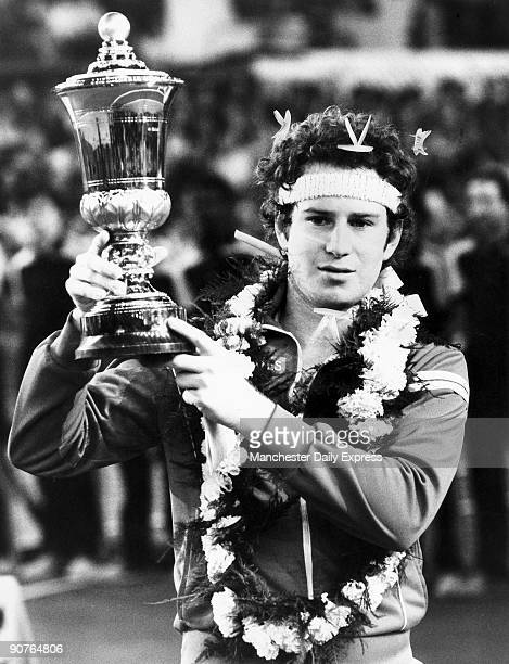 McEnroe with tennis trophy possibly the US Open McEnroe won three singles titles at Wimbledon and four at the US Open Throughout his career he became...