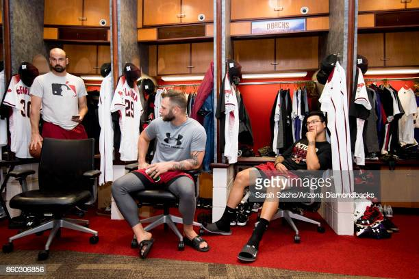 J McFarland Christian Walker and Anthony Banda of the Arizona Diamondbacks hang out in the clubhouse the day before game three of the National League...