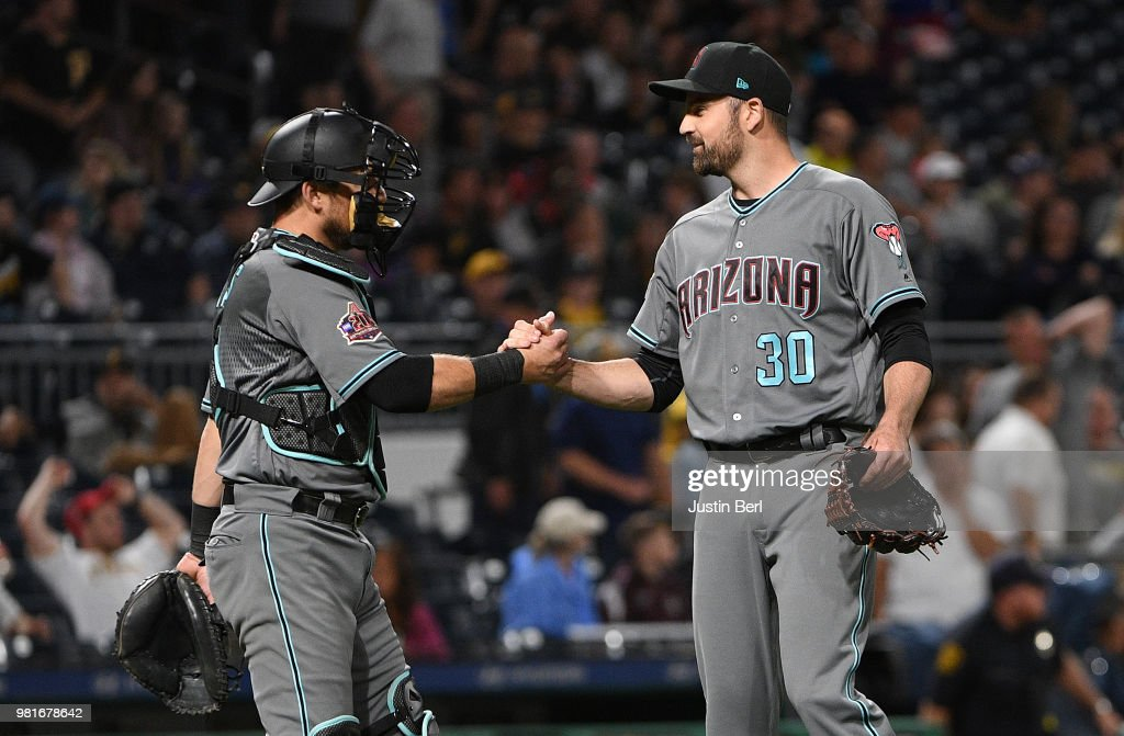T.J. McFarland #30 of the Arizona Diamondbacks shakes hands with Jeff Mathis #2 after the final out in a 2-1 win over the Pittsburgh Pirates in thirteenth innings at PNC Park on June 22, 2018 in Pittsburgh, Pennsylvania.