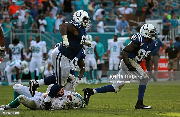 Y McGill and Robert Mathis of the Indianapolis Colts celebrate sacking Ryan Tannehill of the Miami Dolphins during a game at Sun Life Stadium on...