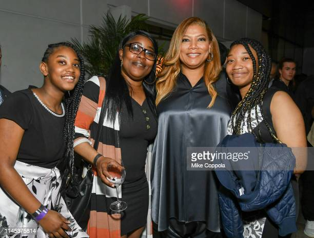 McKayla Blackmon, Jakena Blackman, Queen Latifah, and Janiyah Blackmon pose for a photo at the Tribeca Film Festival After-Party For Queen Collective...