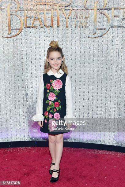 Mckenna Grace arrives at the world premiere of Disney's new liveaction Beauty and the Beast photographed in front of the Swarovski crystal wall at...