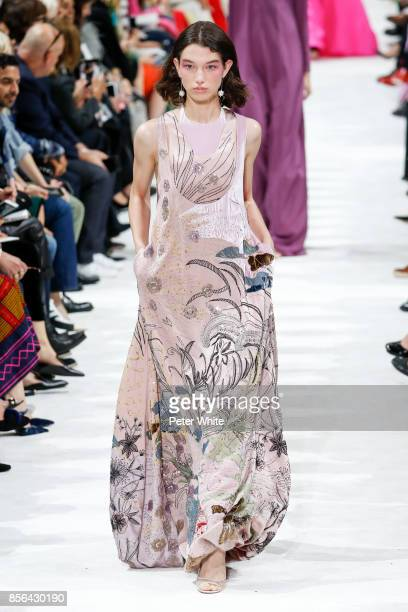 McKenna Hellam walks the runway during the Valentino show as part of the Paris Fashion Week Womenswear Spring/Summer 2018 on October 1 2017 in Paris...