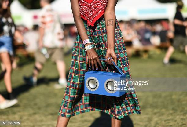 Mckenzie is seen wearing a bandana top plaid skirt and boombox bag during the 2017 Panorama Music Festival Day 3 at Randall's Island on July 30 2017...
