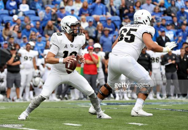 McKenzie Milton of the Central Florida Knights looks to pass as Cole Schneider blocks for him against the Memphis Tigers on October 13 2018 at...