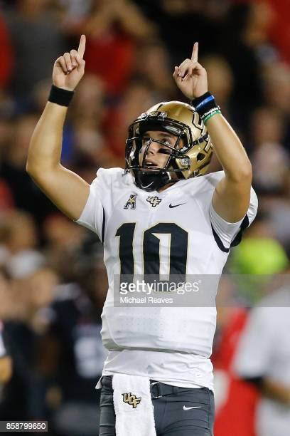 McKenzie Milton of the UCF Knights celebrates a touchdown pass against the Cincinnati Bearcats during the first half at Nippert Stadium on October 7...