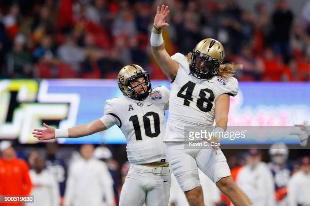 McKenzie Milton of the UCF Knights celebrates with Mac Loudermilk after rushing for a touchdown in the second quarter against the Auburn Tigers...