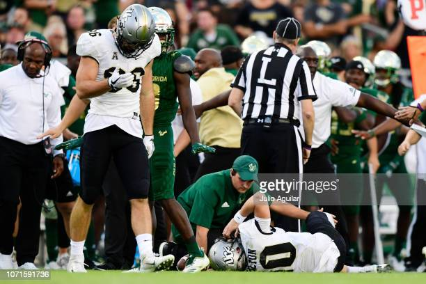 McKenzie Milton of the UCF Knights injures his right knee during a run in the second quarter against the South Florida Bulls at Raymond James Stadium...