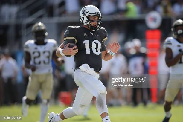 McKenzie Milton of the UCF Knights runs into the end zone for a touchdown during a game between the Pittsburgh Panthers and the UCF Knights at...