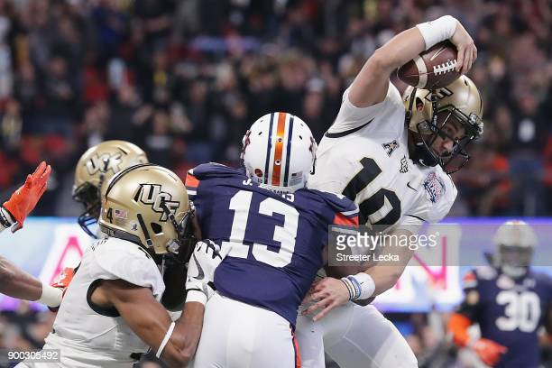 McKenzie Milton of the UCF Knights scores a rushing touchdown in the second quarter against the Auburn Tigers during the ChickfilA Peach Bowl at...