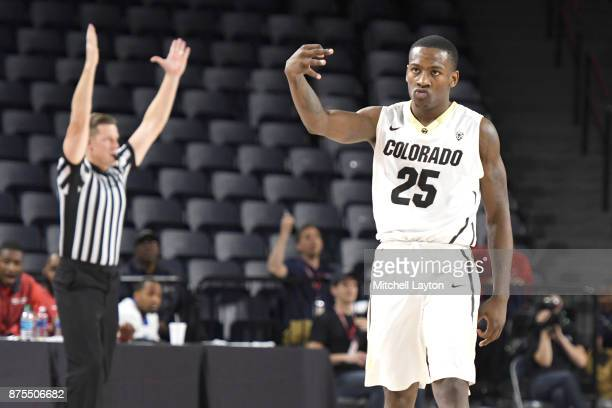 McKinley Wright IV of the Colorado Buffaloes celebrates hitting a game winning shot during quarterfinal of the Paradise Jam college basketball...