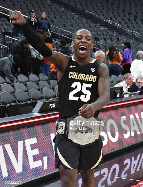 McKinley Wright IV of the Colorado Buffaloes celebrates with the championship belt after the team's 7167 victory over the Clemson Tigers to win the...